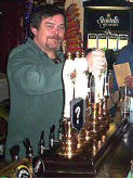 Mr P. J. Riordan with the Charlton's traditional beer pumps (2004) and ..